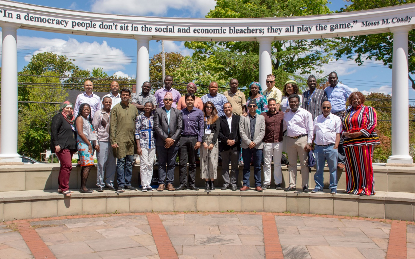 Coady's May 27 – June 13 2018, 24 ''Livelihoods and Markets'' participants (with their facilitators: Prof. Yogesh Ghore, sixth from right in the front row and Dr. Farouk Jiwa, first from left at the rear. The author: Mrs Edel-Quinn Tobs-Agbaegbu is the first from right in the front row.